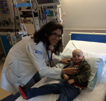Examining a child with cancer