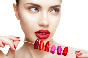 beautiful woman with professional make-up makes choice between d