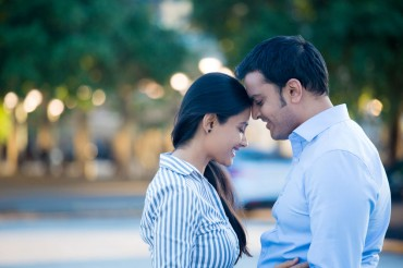 39621796 - closeup portrait, young couple in blue shirt, head to head, eyes closed in love smitten, isolated outdoors outside background. happy moments, positive emotions