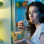 woman eating fridge chips