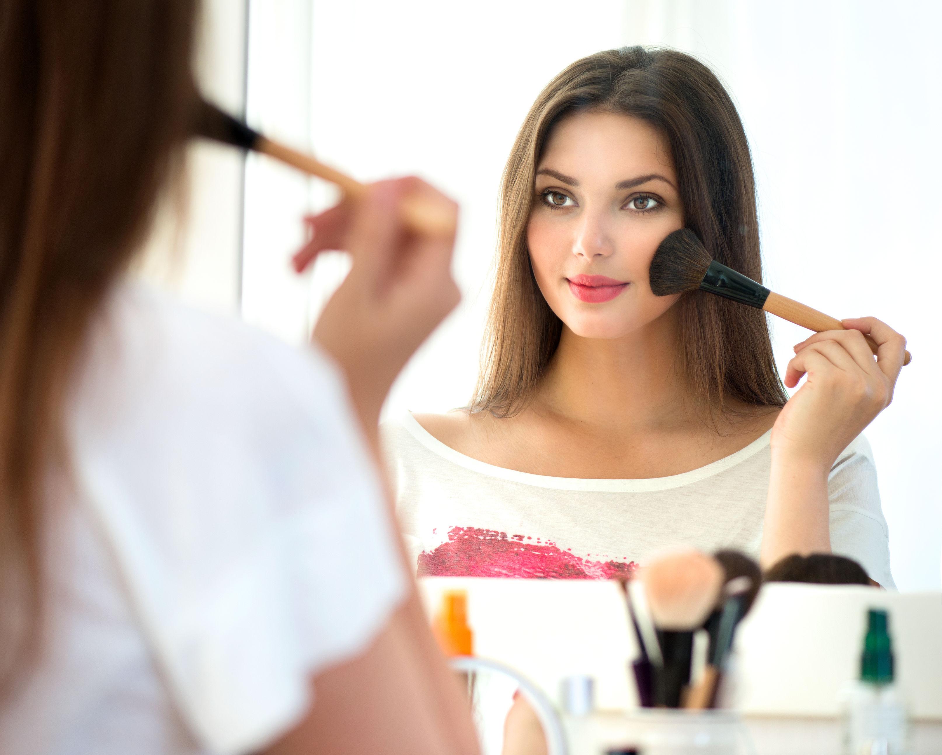 Girl applying blush