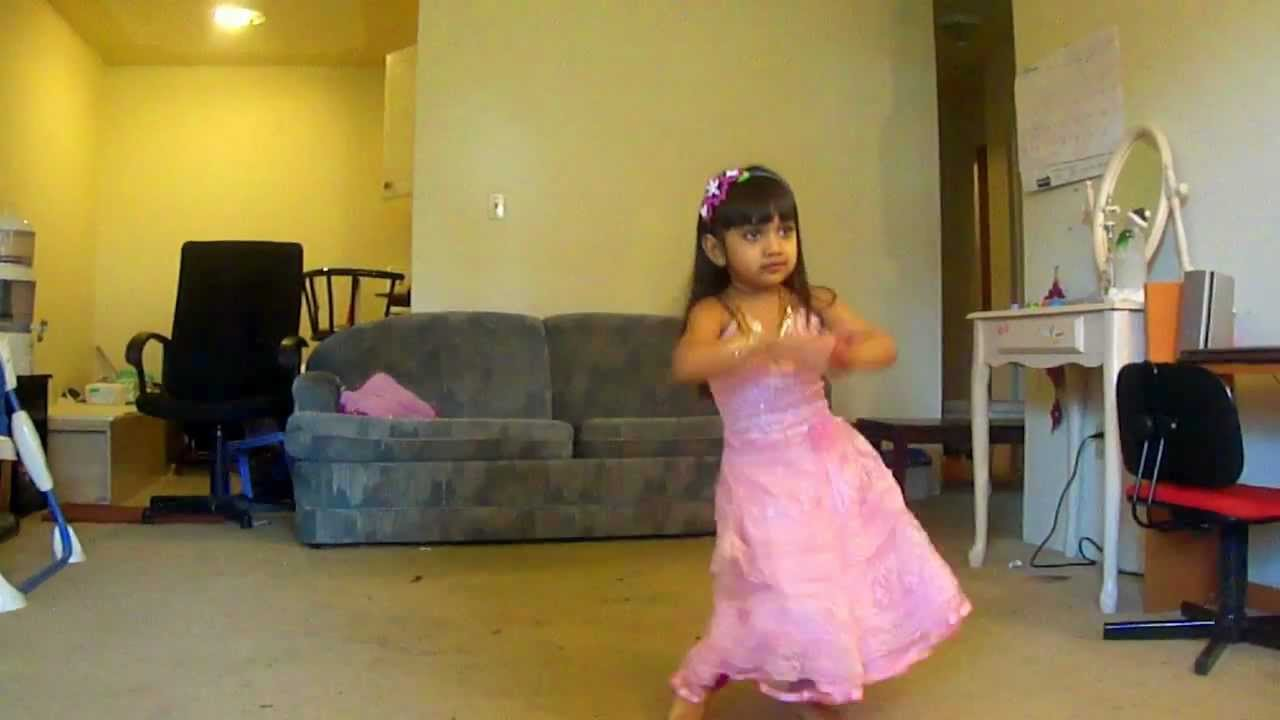 kid dancing in front of TV