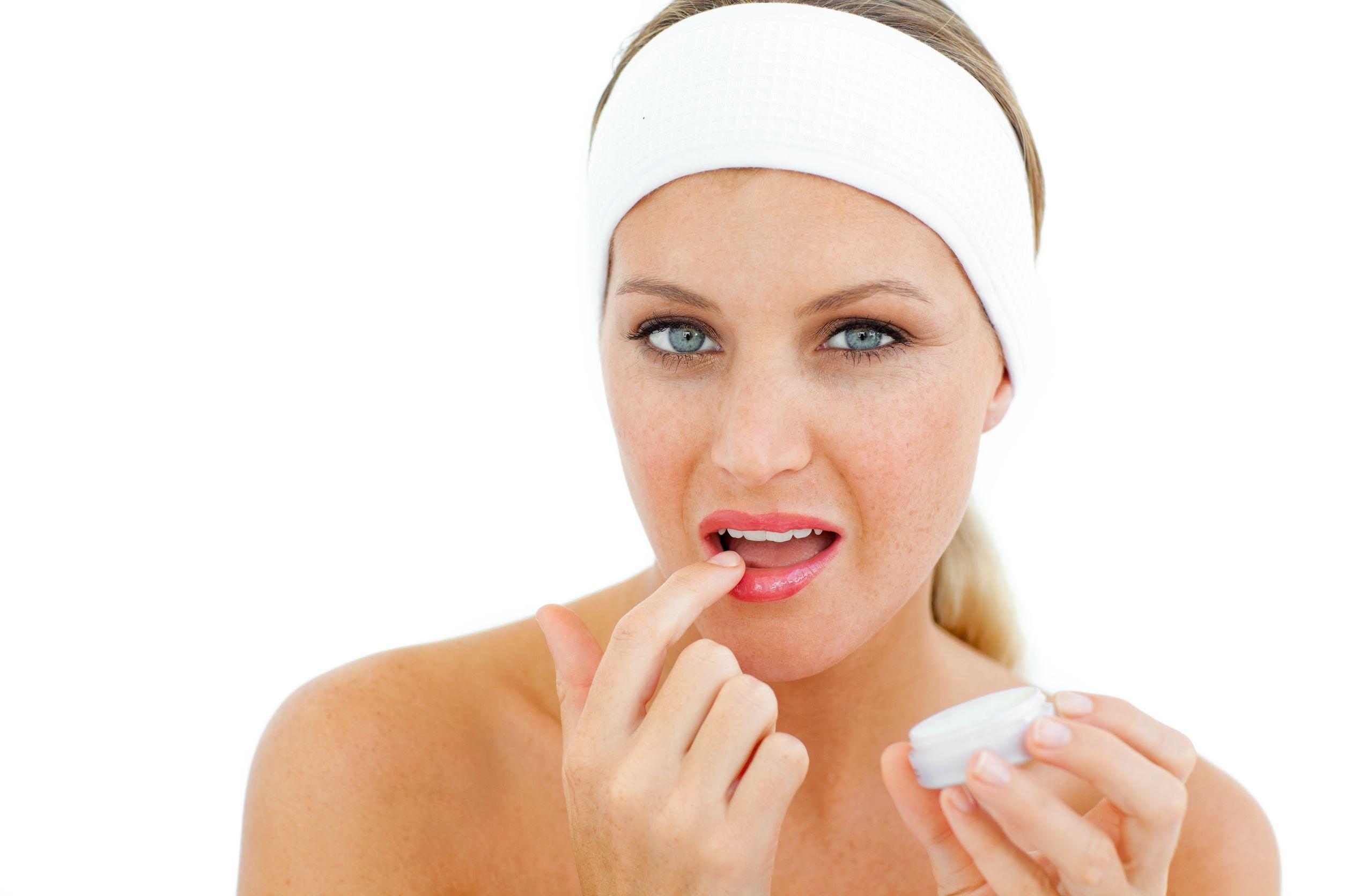 girl applying lip balm