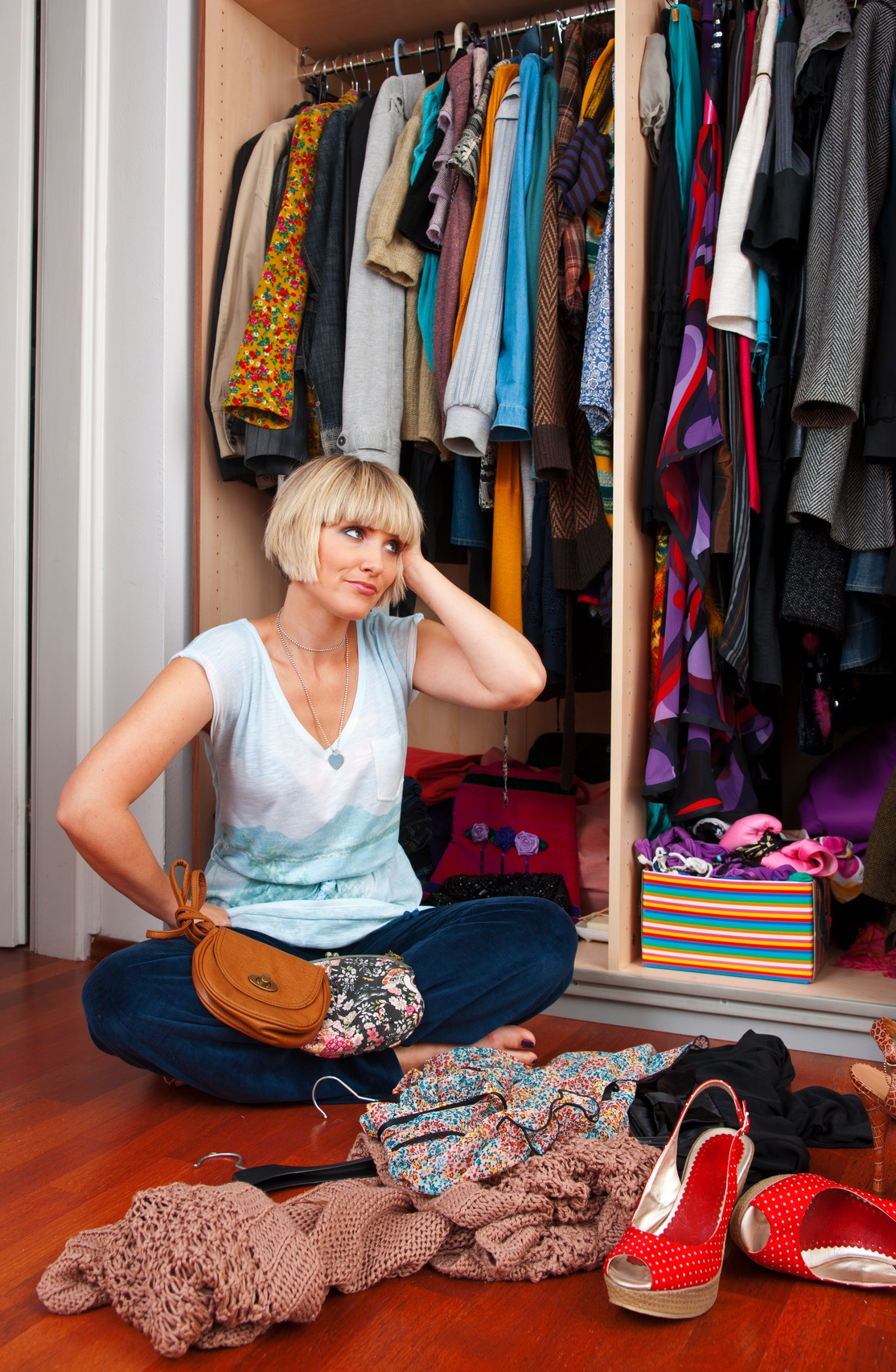 woman in front of full closet